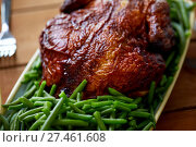 Купить «close up of roast chicken with green beans», фото № 27461608, снято 5 октября 2017 г. (c) Syda Productions / Фотобанк Лори