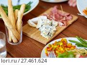 Купить «blue cheese and breadsticks on table», фото № 27461624, снято 5 октября 2017 г. (c) Syda Productions / Фотобанк Лори