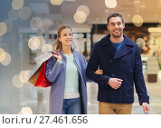 Купить «happy young couple with shopping bags in mall», фото № 27461656, снято 10 ноября 2014 г. (c) Syda Productions / Фотобанк Лори