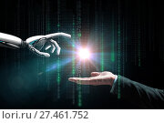 Купить «robot and human hand flash light and binary code», фото № 27461752, снято 6 сентября 2016 г. (c) Syda Productions / Фотобанк Лори