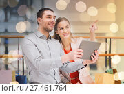 Купить «couple with tablet pc and shopping bags in mall», фото № 27461764, снято 10 ноября 2014 г. (c) Syda Productions / Фотобанк Лори