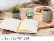 Купить «diary, tea and candle in holder at home», фото № 27461824, снято 15 ноября 2017 г. (c) Syda Productions / Фотобанк Лори