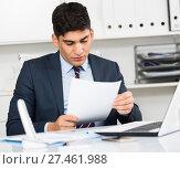 Male is reading documents about the transaction. Стоковое фото, фотограф Яков Филимонов / Фотобанк Лори