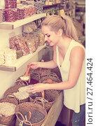 Купить «Woman buying dried beans by weight», фото № 27464424, снято 15 ноября 2018 г. (c) Яков Филимонов / Фотобанк Лори