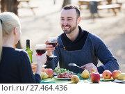 Купить «Couple having picnic at countryside», фото № 27464436, снято 17 ноября 2018 г. (c) Яков Филимонов / Фотобанк Лори