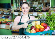 friendly vendor with range of vegetables and fruits in basket. Стоковое фото, фотограф Яков Филимонов / Фотобанк Лори