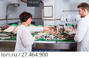 Купить «customers choosing seafood», фото № 27464900, снято 25 октября 2016 г. (c) Яков Филимонов / Фотобанк Лори