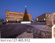 Купить «Christmas (New Year holidays) decoration Lubyanskaya (Lubyanka) Square in the evening, Moscow, Russia. Inscription in Russian - happy new year», фото № 27465912, снято 9 января 2018 г. (c) Владимир Журавлев / Фотобанк Лори