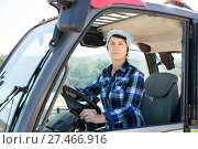 Купить «Adult woman farmer in the car at the cow farm», фото № 27466916, снято 24 октября 2017 г. (c) Яков Филимонов / Фотобанк Лори