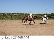 Купить «Молодая девушка на лошади. Конный спорт», эксклюзивное фото № 27468144, снято 17 августа 2013 г. (c) Юрий Морозов / Фотобанк Лори