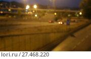 Купить «Blurred view of city highway in dusk with trace of red automobile headlight beams», видеоролик № 27468220, снято 11 августа 2017 г. (c) Яков Филимонов / Фотобанк Лори