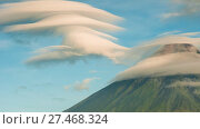 Купить «Mayon Volcano with the ventricular of clouds. TimeLapse in sunrise. Active stratovolcano in the province of Albay in Bicol Region, on the island of Luzon in the Philippines.», видеоролик № 27468324, снято 26 января 2018 г. (c) Mikhail Davidovich / Фотобанк Лори