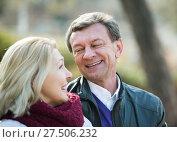Купить «Elderly couple sitting on bench and talking», фото № 27506232, снято 20 сентября 2018 г. (c) Яков Филимонов / Фотобанк Лори