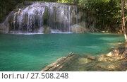 Erawan Waterfall with fish in water in Thailand (2018 год). Стоковое видео, видеограф Михаил Коханчиков / Фотобанк Лори