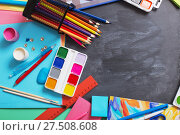 Купить «School stationery on background blackboard», фото № 27508608, снято 25 декабря 2017 г. (c) Майя Крученкова / Фотобанк Лори