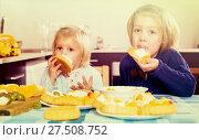Купить «Two little girls with cream desserts», фото № 27508752, снято 14 декабря 2018 г. (c) Яков Филимонов / Фотобанк Лори