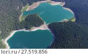 Купить «Aerial view of Black Lake in Durmitor, Montenegro», видеоролик № 27519856, снято 15 декабря 2017 г. (c) Михаил Коханчиков / Фотобанк Лори
