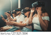 Girl watching exciting movie with VR glasses. Стоковое фото, фотограф Яков Филимонов / Фотобанк Лори