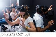 Купить «Young people enjoy virtual reality», фото № 27521508, снято 6 июля 2017 г. (c) Яков Филимонов / Фотобанк Лори