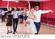 Купить «Dancing couples enjoying latin dances», фото № 27521672, снято 24 мая 2017 г. (c) Яков Филимонов / Фотобанк Лори