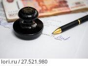 Купить «Работа с документами. Подпись под документом. Шариковая ручка,деньги и печать организации лежат на деловых бумагах», эксклюзивное фото № 27521980, снято 29 января 2018 г. (c) Игорь Низов / Фотобанк Лори