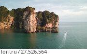 Купить «Aerial view of tropical lagoon beach between rocks», видеоролик № 27526564, снято 26 января 2018 г. (c) Михаил Коханчиков / Фотобанк Лори