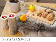 Купить «cookies, lemon tea and candles on table at home», фото № 27534632, снято 15 ноября 2017 г. (c) Syda Productions / Фотобанк Лори