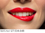 Купить «close up of woman with red lipstick biting lip», фото № 27534648, снято 5 января 2018 г. (c) Syda Productions / Фотобанк Лори