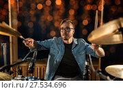 Купить «musician playing drum kit at concert over lights», фото № 27534696, снято 18 августа 2016 г. (c) Syda Productions / Фотобанк Лори