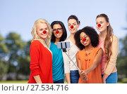 Купить «group of women taking selfie at red nose day», фото № 27534716, снято 18 марта 2017 г. (c) Syda Productions / Фотобанк Лори