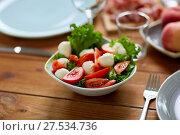 Купить «vegetable salad with mozzarella on wooden table», фото № 27534736, снято 5 октября 2017 г. (c) Syda Productions / Фотобанк Лори