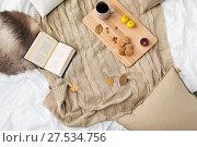 Купить «cookies, lemon tea, book and leaves in bed», фото № 27534756, снято 15 ноября 2017 г. (c) Syda Productions / Фотобанк Лори