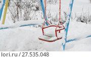 Купить «snow covered swing at a playground in winter», видеоролик № 27535048, снято 31 января 2018 г. (c) Володина Ольга / Фотобанк Лори