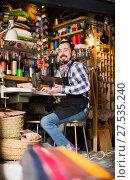 Купить «male worker sewing stitches on belt in leather workshop», фото № 27535240, снято 22 марта 2019 г. (c) Яков Филимонов / Фотобанк Лори