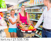 Купить «Positive family with teen daughter and purchases in shopping», фото № 27535736, снято 11 июля 2017 г. (c) Яков Филимонов / Фотобанк Лори