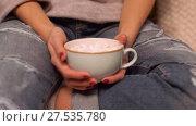 Купить «woman holding cup of cacao with marshmallow», видеоролик № 27535780, снято 23 января 2018 г. (c) Syda Productions / Фотобанк Лори
