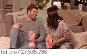 Купить «happy couple eating pop corn at home», видеоролик № 27535788, снято 23 января 2018 г. (c) Syda Productions / Фотобанк Лори