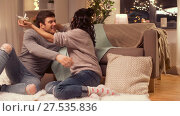 Купить «happy couple with gift box at home», видеоролик № 27535836, снято 23 января 2018 г. (c) Syda Productions / Фотобанк Лори