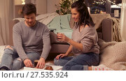 Купить «happy couple drinking coffee and eating at home», видеоролик № 27535924, снято 23 января 2018 г. (c) Syda Productions / Фотобанк Лори
