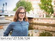Купить «Smile young woman on Griboyedov channel embankment in Saint-Peterburg», фото № 27536124, снято 24 июля 2017 г. (c) Сергей Дубров / Фотобанк Лори
