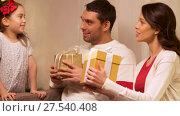Купить «happy family with christmas present at home», видеоролик № 27540408, снято 17 января 2018 г. (c) Syda Productions / Фотобанк Лори