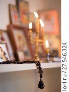 Купить «candle against the background of orthodox icons», фото № 27546324, снято 1 февраля 2018 г. (c) Типляшина Евгения / Фотобанк Лори