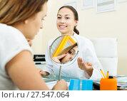 Купить «Woman client checking result of beauty procedures», фото № 27547064, снято 21 февраля 2019 г. (c) Яков Филимонов / Фотобанк Лори