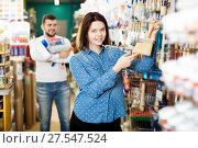 Купить «Couple examining various painting brushes», фото № 27547524, снято 9 марта 2017 г. (c) Яков Филимонов / Фотобанк Лори