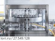 Купить «The machine for washing glass bottles.», фото № 27549128, снято 5 июля 2017 г. (c) Андрей Радченко / Фотобанк Лори