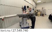 Купить «The milling cutter measures the parts and prepares the machine for work», видеоролик № 27549740, снято 19 октября 2017 г. (c) Андрей Радченко / Фотобанк Лори