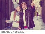 Купить «Smiling couple man and woman with map», фото № 27550332, снято 18 ноября 2017 г. (c) Яков Филимонов / Фотобанк Лори