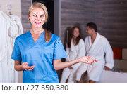 Купить «Young female is meeting her clients for relaxation massage», фото № 27550380, снято 18 июля 2017 г. (c) Яков Филимонов / Фотобанк Лори