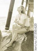 Купить «Cheerful female is posing on the rocks in her free time», фото № 27550620, снято 17 июля 2017 г. (c) Яков Филимонов / Фотобанк Лори