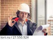 Купить «A construction worker gives you the okay sign, signaling that everything is a-okay. Soft focus, toned.», фото № 27550924, снято 27 февраля 2020 г. (c) Marina Sharova / Фотобанк Лори